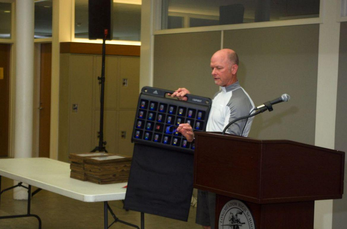 Grant Recipient Peter Bradshow shows off Activity Trackers